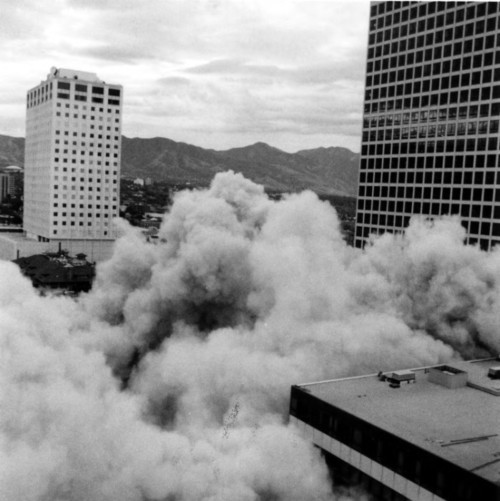 Photo courtesy Marriott Library Dust rises near the hotel during a downtown demolition in 1984. Thursday is Hotel Utah's 100th anniversary.