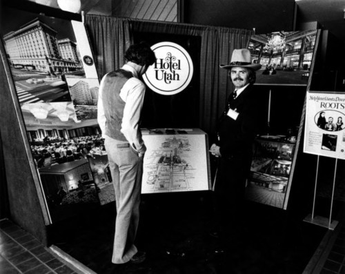 Photo courtesy Marriott Library Visitors look at a Hotel Utah display. Thursday is Hotel Utah's 100th anniversary.