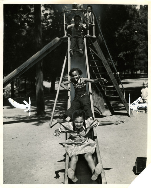 Children play on a slide at Liberty Park in this photo dated July 18, 1937. Tribune file photo