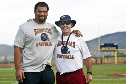 Chris Detrick  |  The Salt Lake Tribune  Haloti Ngata and high school coach Larry Wilson pose for a portrait during a football camp at Herriman High School.