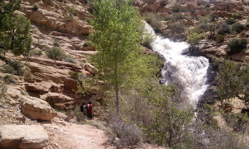 Jason Bergreen  |  The Salt Lake Tribune Hikers approaching Faux Falls outside of Moab near Ken's Lake.