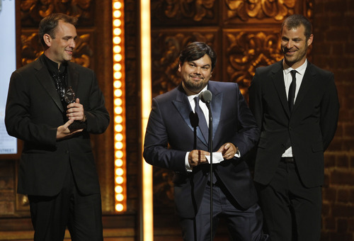 From left, Trey Parker, Robert Lopez and Matt Stone accept the award for Best Book of a Musical for