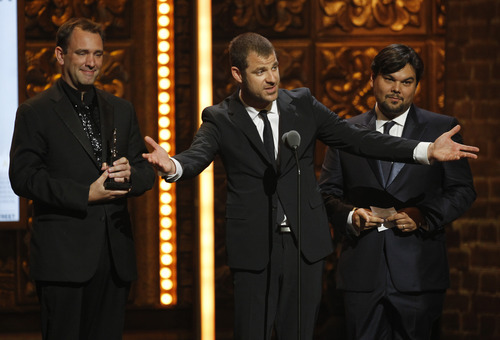 From left, Trey Parker, Matt Stone and Robert Lopez accept the award for Best Book of a Musical for