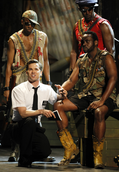 Andrew Rannells, left, and the cast of