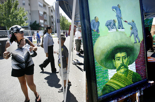 File photo  |  The Salt Lake Tribune  People walk by a booth where the art of Jimmy Lucero was on display during the Mestizo West Side Arts Festival in July 2010.  Lucero's acrylic work titled