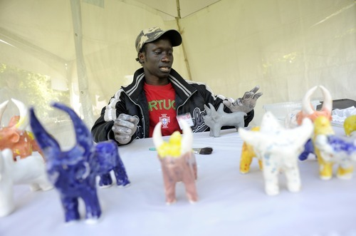 File photo  |  The Salt Lake Tribune  Dominic Raimondi, of Salt Lake City, makes a Sudanese clay bull at the first day of the Living Traditions Festival in May in downtown Salt Lake City. Raimondi started making the bulls as a child in Sudan. The annual festival celebrates the city's folk and ethnic arts through performance, food and crafts.