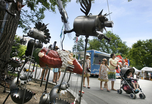 File photo  |  The Salt Lake Tribune  Utah Arts Festival visitors walk past some of Salt Lake artist Fred Conlon's whimsical creatures including flying pigs and creatures carrying off gnomes in June 2010.