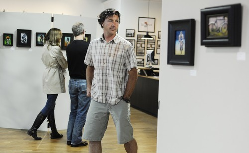 File photo  |  The Salt Lake Tribune  Jeff Thornton, of Salt Lake City, looks at local bicycle-themed art at Salt Lake City Bicycle Co. for the third annual Bike Art Show during the gallery stroll in May in downtown Salt Lake City. The bike-themed art was part of the National Bike Month events.