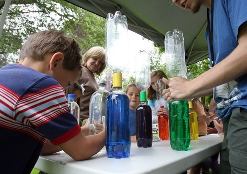 Steve Griffin  |  The Salt Lake Tribune  Children make tornados in bottles during Weber State University's
