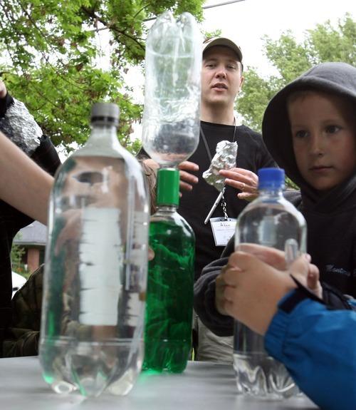 Steve Griffin  |  The Salt Lake Tribune  Weber State University's Adam Johnston watches children make tornados in bottles during