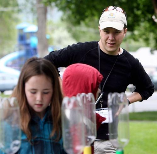 Steve Griffin  |  The Salt Lake Tribune  Weber State University's Adam Johnston keeps an eye on the children during