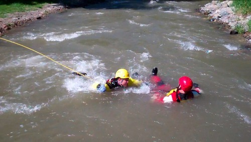 Cimaron Neugebauer | The Salt Lake Tribune  Firefighters conduct swift water rescue training at Murray Park on Tuesday morning.