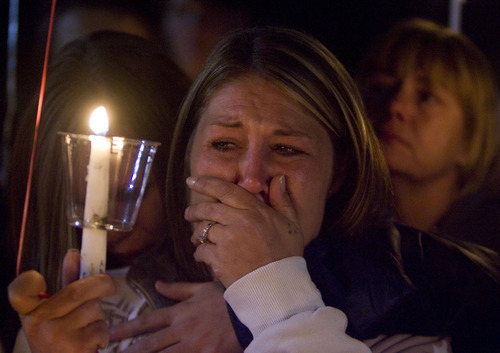 Ronnie Lee Gardner's daughter Brandie Gardner is comforted by friends and family during a candlelight vigil after his execution at the Utah State Prison in this June 18, 2010 Tribune file photo.