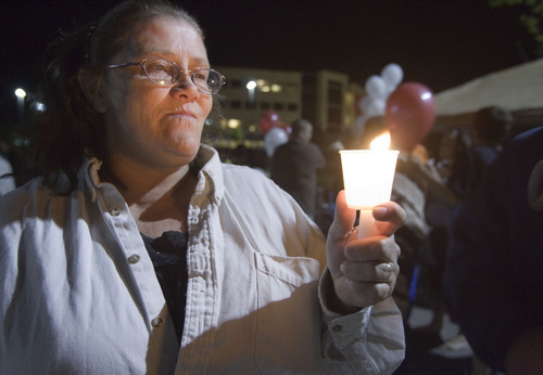 File photo  |  The Salt Lake TribuneBonnie Gardner, a sister of Ronnie Lee Gardner, holds a candle at a gathering of Ronnie Lee Gardner supporters June 17, 2010, across from the Utah State Prison in Draper. Ronnie Lee Gardner was executed by firing squad later that evening.