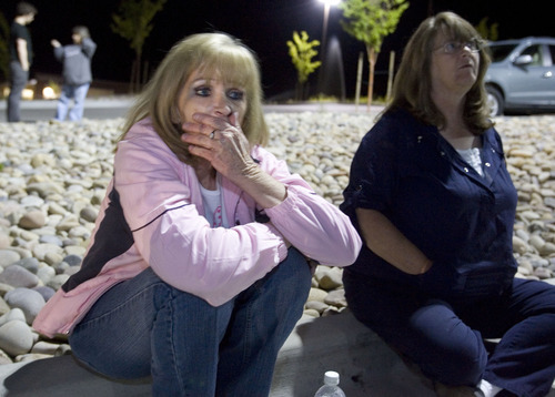 File photo  |  The Salt Lake TribuneBarb Webb, the daughter of Nick Kirk, who was shot by Ronnie Lee Gardner, talks with family friend Pam Todd, right, about her dad June 17, 2010, across from the Utah State Prison in Draper. Ronnie Lee Gardner was executed by firing squad later that evening.