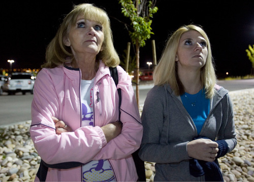 Barb Webb, the daughter of Nick Kirk, who was shot by Ronnie Lee Gardner, left, talks with Barb's daughter Mandi Hull, right, and look to the sky as balloons are released by supporters of Ronnie Lee Gardner in this Friday, June 18, 2010, Tribune file photo.