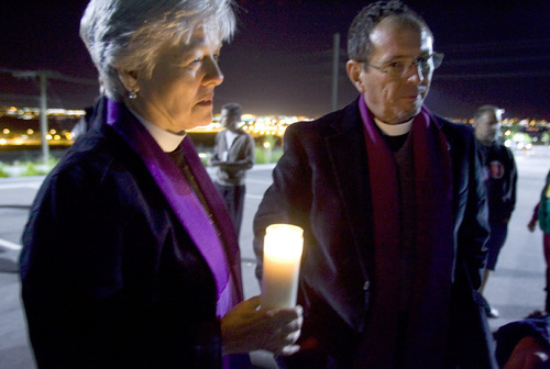Jim Urquhart  |  The Salt Lake TribunePastor Jessica Hatch of St. Mary's Episcopal Church in Provo, left,  and Pastor Rick Whittaker of St. Barnabas Episcopal Church in Tooele attend a candlelight vigil at a gathering of Ronnie Lee Gardner supporters Friday, June 18, 2010, across from the Utah State Prison in Draper. Ronnie Lee Gardner was executed by firing squad.