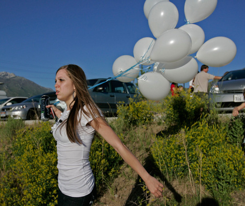 Jim Urquhart  |  The Salt Lake TribuneAn unidentified supporter of Ronnie Lee Gardner brings balloons to a gathering of family and friends across from the Utah State Prison in Draper in this June 17, 2010 file photo.