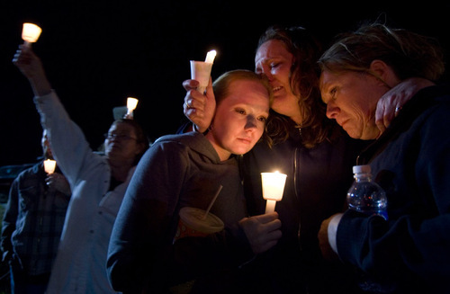 Family members and supporters cry during a candlelight vigil at a gathering of Ronnie Lee Gardner supporters across from the Utah State Prison in Draper in this June 17, 2010, Tribune file photo.
