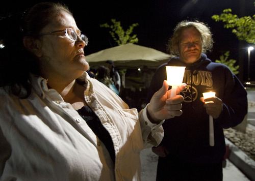 File photo  |  The Salt Lake TribuneBonnie Gardner, a sister of Ronnie Lee Gardner, left, and family friend Scott Hanes, hold candles at a gathering of Ronnie Lee Gardner supporters June 17, 2010, across from the Utah State Prison in Draper. Ronnie Lee Gardner was executed by firing squad later that evening.