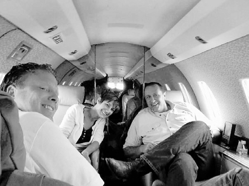 Facebook photo from a Johnson associate Jeremy Johnson, left, Utah Attorney General Mark Shurtleff, right, and Sandra Lucus are pictured in Johnson's jet on a trip to southern California to raise money for Lucus' Meth Cops program.