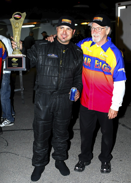 Dale Pulde, right, and the driver of his car, James Day, after winning the Prostalgia Nitro Funny Car class during Friday night's Salt Lake Nitro Jam at Rocky Muntain Raceway. Pulde was back at the race track for the first time after a nearly fatal bout with