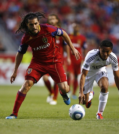 Djamila Grossman  |  The Salt Lake Tribune  Real Salt Lake plays D.C. United at Rio Tinto Stadium in Sandy, Utah, on Saturday, June 18, 2011.  RSL's Fabian Espindola (7) defends the ball against D.C.'s Andy Najar (14), in the second half of the game.