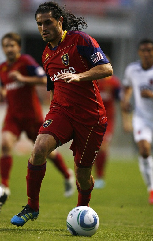 Djamila Grossman  |  The Salt Lake Tribune  Real Salt Lake plays D.C. United at Rio Tinto Stadium in Sandy, Utah, on Saturday, June 18, 2011.  RSL's Fabian Espindola (7) drives the ball down the field in the second half of the game.