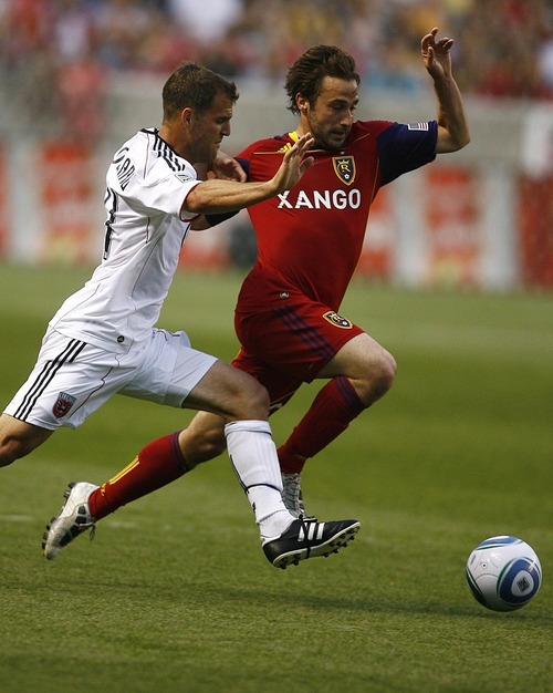 Djamila Grossman  |  The Salt Lake Tribune  Real Salt Lake plays D.C. United at Rio Tinto Stadium in Sandy, Utah, on Saturday, June 18, 2011.  RSL's Ned Grabavoy (20) and D.C.'s Daniel Woolard (21) drive the ball down the field.