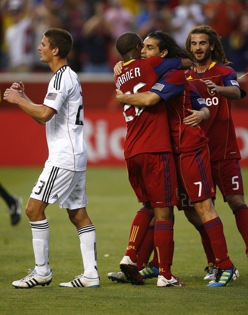 Djamila Grossman  |  The Salt Lake Tribune  Real Salt Lake plays D.C. United at Rio Tinto Stadium in Sandy, Utah, on Saturday, June 18, 2011.  RSL's Fabian Espindola (7) Kyle Beckerman (5) and Collen Warner (26) cheer after their team scored a goal in a penalty kick.