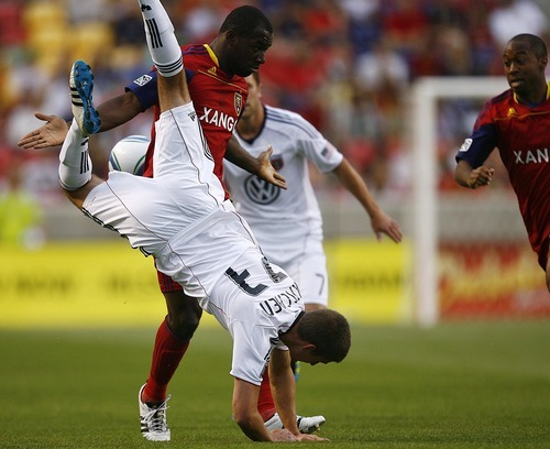 Djamila Grossman  |  The Salt Lake Tribune  Real Salt Lake plays D.C. United at Rio Tinto Stadium in Sandy, Utah, on Saturday, June 18, 2011.  RSL's Jean Alexandre (12) looks on as D.C.'s Perry Kitchen (23) jumps over him and falls to control the ball.