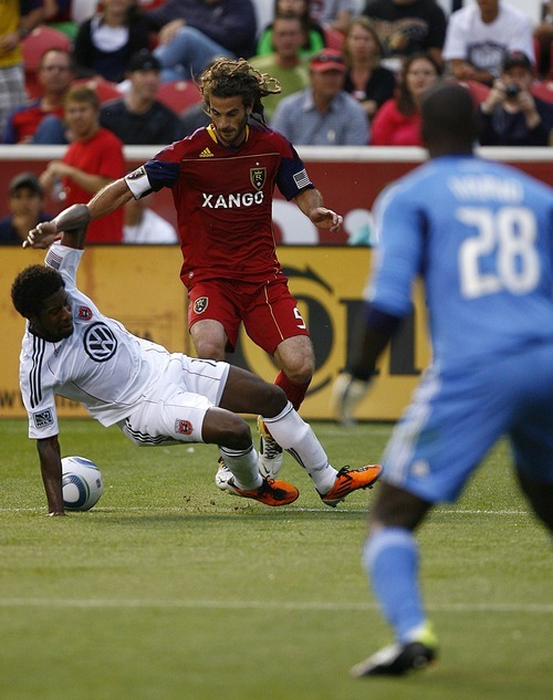 Djamila Grossman  |  The Salt Lake Tribune RSL's Kyle Beckerman trails D.C.'s Clyde Simms, whose foul led to a penalty kick and a goal for RSL in the first half.