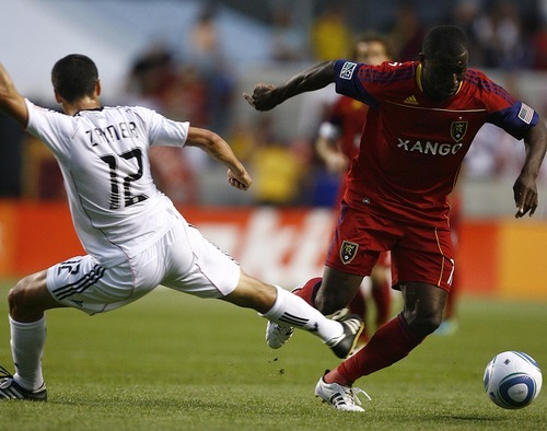 Djamila Grossman  |  The Salt Lake Tribune  Real Salt Lake plays D.C. United at Rio Tinto Stadium in Sandy, Utah, on Saturday, June 18, 2011.  RSL's Jean Alexandre (12) drives around D.C.'s Jed Zayner (12), in the second half of the game.