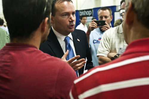 Chris Detrick  |  The Salt Lake Tribune  Sen. Mike Lee talks to supporters during the Utah State Republican Party Convention at the South Towne Expo Center on Saturday.