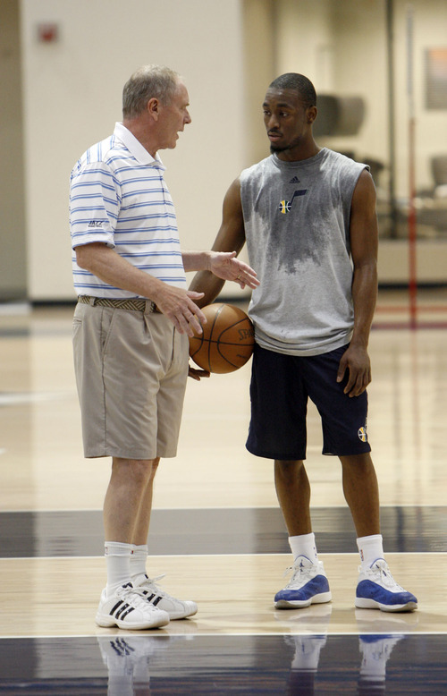 Francisco Kjolseth  |  The Salt Lake Tribune Utah Jazz general manager Kevin O'Connor speaks with Connecticut guard Kemba Walker after finishing a workout with the Utah Jazz on Wednesday, June 15, 2011, at their practice facility in Salt Lake City.