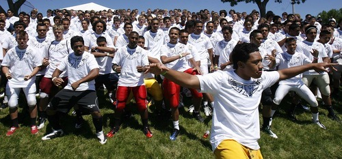 Trent Nelson  |  The Salt Lake Tribune Foai Leituala leads players in the haka Friday at the All-Poly football camp, held at Millcreek Junior High School.