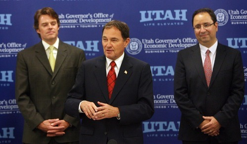 Steve Griffin  |  The Salt Lake Tribune  Utah Governor Gary Herbert, center, stands with Vance Checketts, of EMC, left, and Keyvan Esfarjani, co-executive officer of IM Flash, during an announcement Monday of significant job increases by the two Utah companies.  The announcement was made during a board meeting of the Governor's Office of Economic Development at IM Flash Technologies in Lehi.