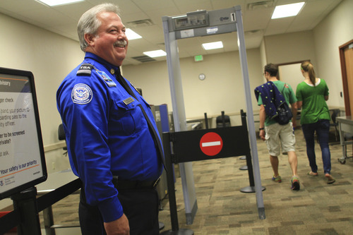 TSA Officer Stan Mecham stands in front of the security checkpoint at the Provo Airport on Monday, June 20, 2011. Frontier Airlines will begin offering daily flights from the Provo Airport. Mario E. Ruiz for the Salt Lake Tribune.
