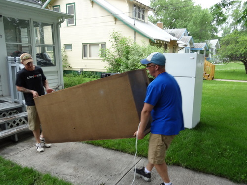 Marshal Platz, left, and Chad Love help relatives move furniture out of the relatives' Minot, N.D., home Tuesday, June 21, 2011. Owner Jessica Love, 26, said they're planning to move everything to higher ground. About 11,000 Minot residents are being ordered to leave their homes hours earlier than expected as the Souris River gets closer to swamping the North Dakota city with the worst flooding in four decades, officials said Tuesday. (AP Photo/ The Forum, Teri Finneman)