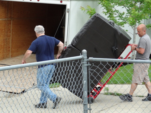 Obed Rodriguez, right, and Tom Drouin prepare to evacuate the Rodriguez home in Minot, N.D., on Tuesday, June 21, 2011. Rodriguez kept a sense of humor about the second round of evacuations.
