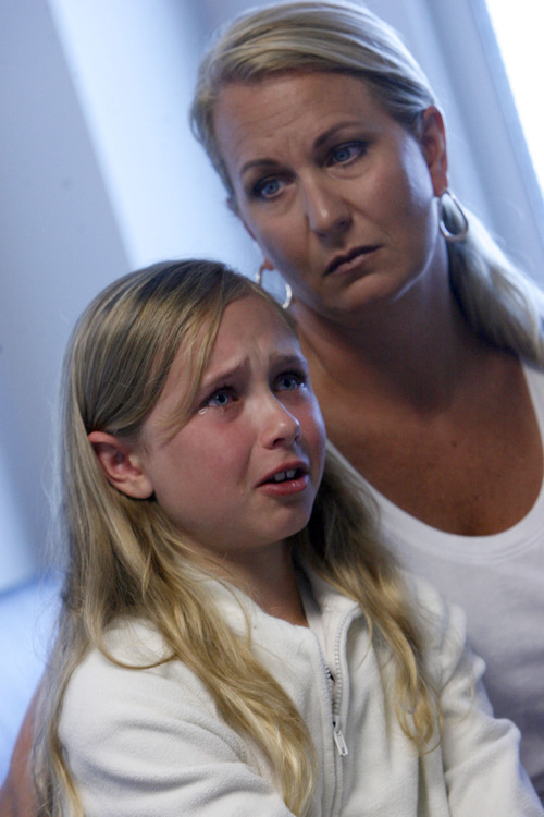 Francisco Kjolseth     The Salt Lake Tribune Madison Grundstrom, 10, recounts Cody's ordeal as she is comforted by her mother, Jenney.
