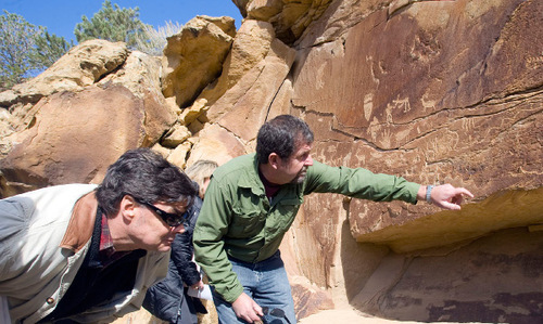Al Hartmann  |  The Salt Lake Tribune  Jim Felton, communication manager for Bill Barrett Corp., left, and Jerry Spangler, of the Colorado Plateau Archaelogical Alliance, look for rock art below a large panel called the Owl panel in Nine Mile Canyon.  Bill Barrett Corp. operates many gas wells in the area and has agreed to fund cultural resources field work, monitoring, rock art conservation and mitigation plans.