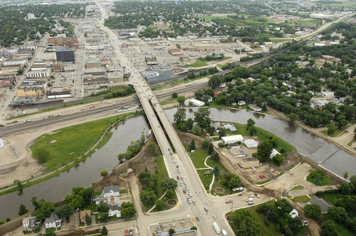 The swelling Souris River runs through Minot, N.D. on Wednesday, June 22, 2011. (AP Photo/Will Kincaid)