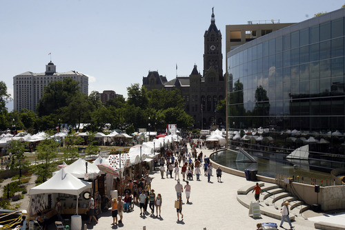 Rick Egan   |  The Salt Lake Tribune Crowds brave the midday sun at the Utah Arts Festival.