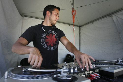 Rick Egan   |  The Salt Lake Tribune Antonio Cruz Martinez, of Ogden, works as a disc jockey in the Urban Arts zone.