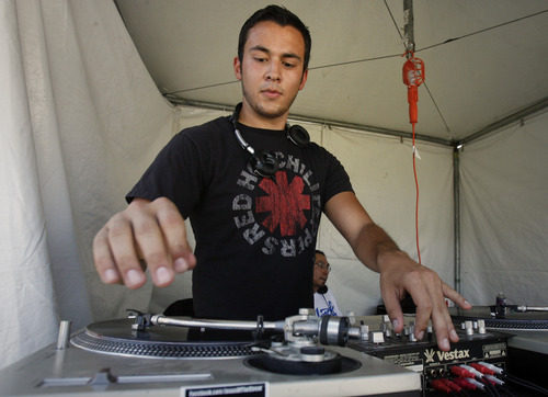Rick Egan   |  The Salt Lake Tribune DJ Antonio Cruz Martinez works his magic.