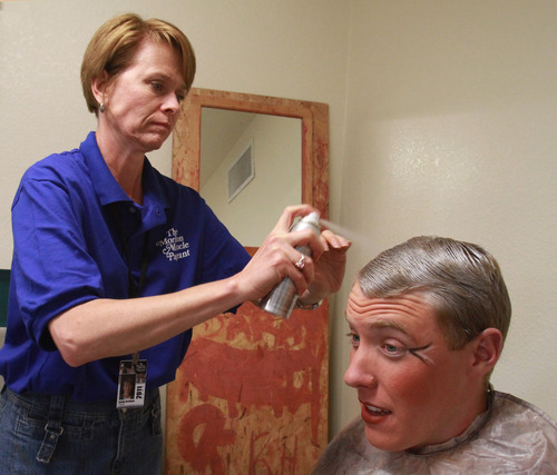 Rick Egan   |  The Salt Lake Tribune  Jacque Sorenson sprays John Pipes  hair silver, for his part as Angel Moroni, for the dress rehearsal for the Mormon Miracle Pageant, Tuesday, June 14, 2011.