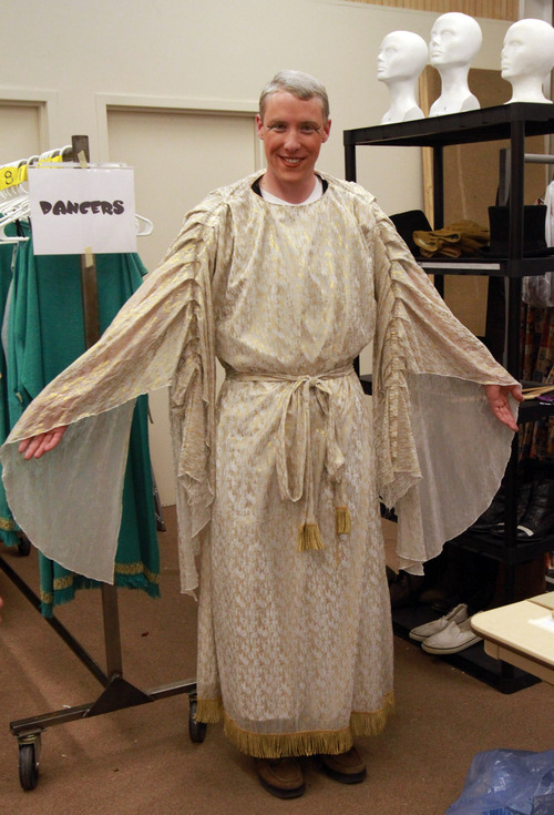 Rick Egan   |  The Salt Lake Tribune  John Pipes gets tries on his costume, for his part as Angel Moroni, for the dress rehearsal for the Mormon Miracle Pageant, Tuesday, June 14, 2011.
