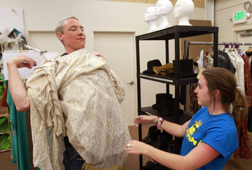 Rick Egan   |  The Salt Lake Tribune  Alex Hancock, costume director, (right) helps John Pipes get his costume on, for his part as Angel Moroni, for the dress rehearsal for the Mormon Miracle Pageant, Tuesday, June 14, 2011.