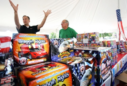 Steve Griffin  |  The Salt Lake Tribune  Theron Watson, left, demonstrates how the newly legalized fireworks perform, as he and his father Ted Watson get one of their Olympus Fireworks tents ready Monday for the fireworks season. Fireworks called